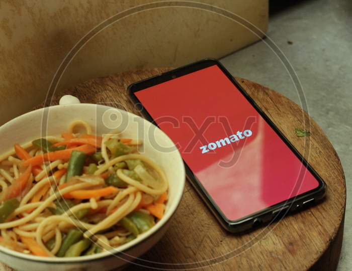 Zomato Food delivery application icon on smartphone