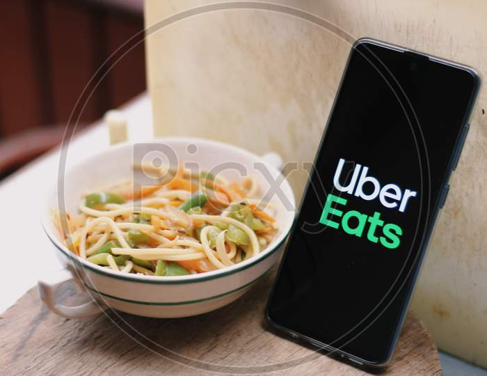 Uber eats Food delivery application icon on smartphone