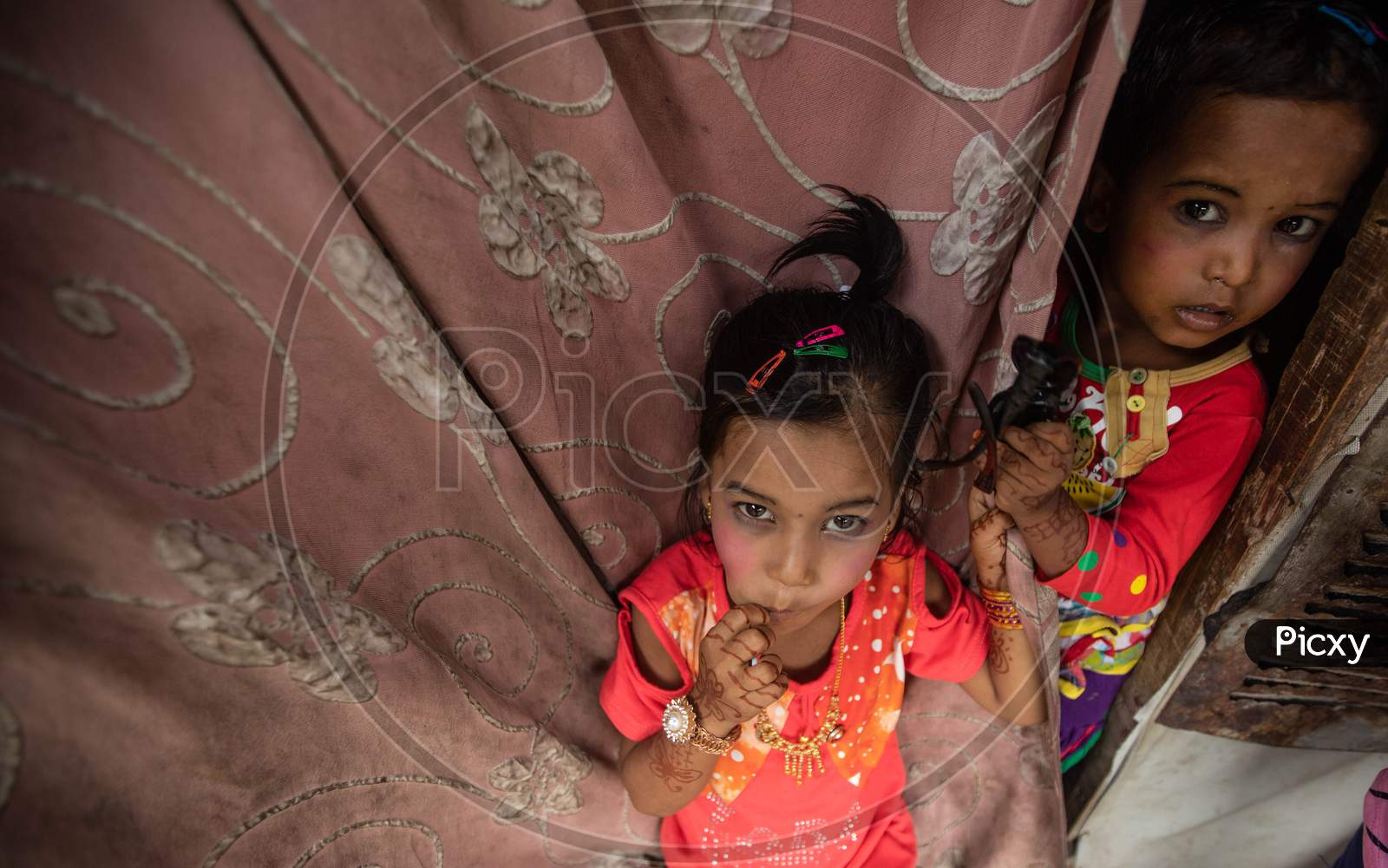 Rohingya refugee children wear new clothes and make up during Eid Al-Adha (Feast of Sacrifice) festival at a camp on the outskirts of New Delhi, India on August 1, 2020.