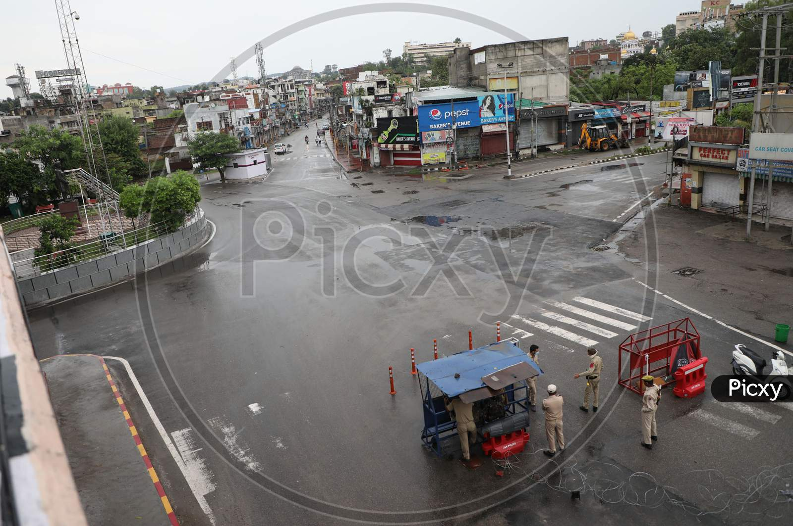 Deserted road is seen after the authorities announced complete lockdown on weekends and public holidays due to surge in COVID-19 cases, in Jammu,on August 1, 2020