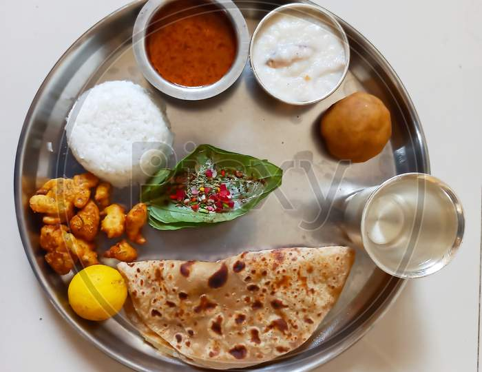 Indian special festival food thali with puranpoli