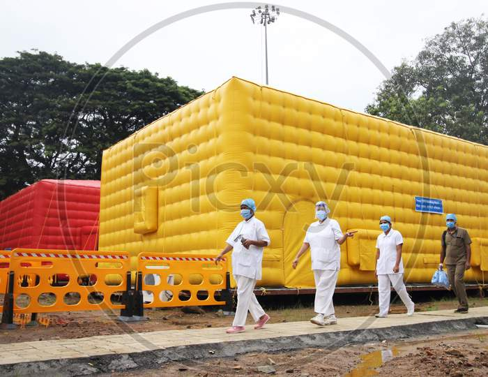 Nurses walk past the newly inaugurated temporary facility created to facilitate cancer patients diagnosed with coronavirus disease (COVID-19) in Mumbai, India on July 30, 2020.
