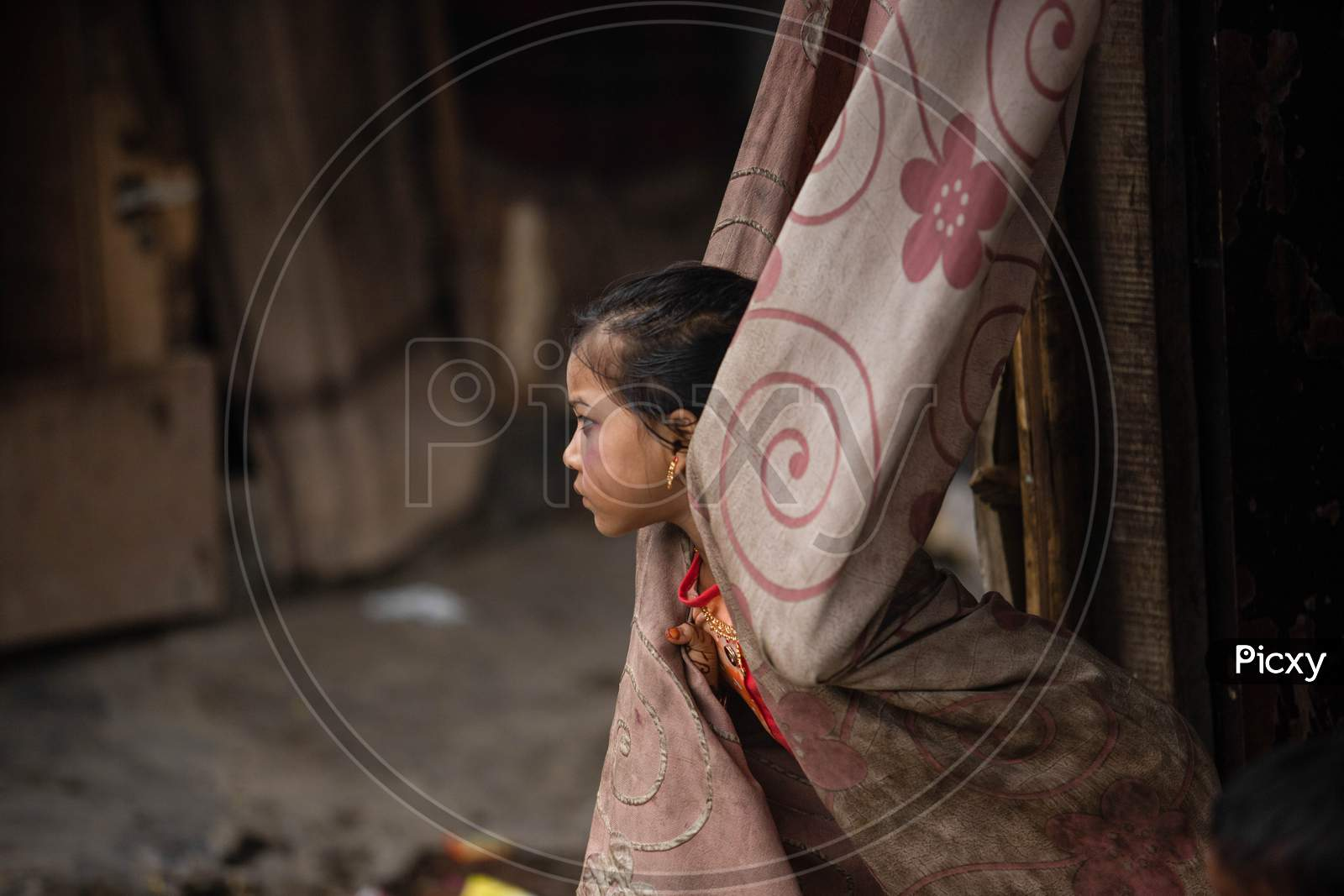 A Rohingya refugee girl wear new clothes and make up during Eid Al-Adha (Feast of Sacrifice) festival at a camp on the outskirts of New Delhi, India on August 1, 2020.