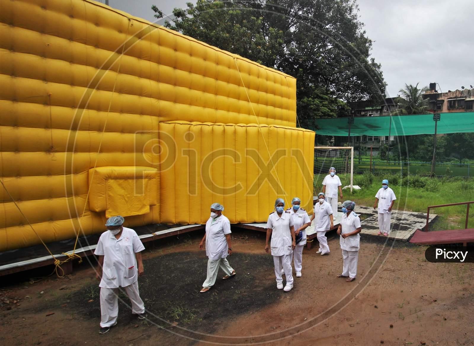 Nurses walk past the newly inaugurated temporary facility created to facilitate cancer patients diagnosed with coronavirus disease (COVID-19) in Mumbai, India on July 30, 2020.