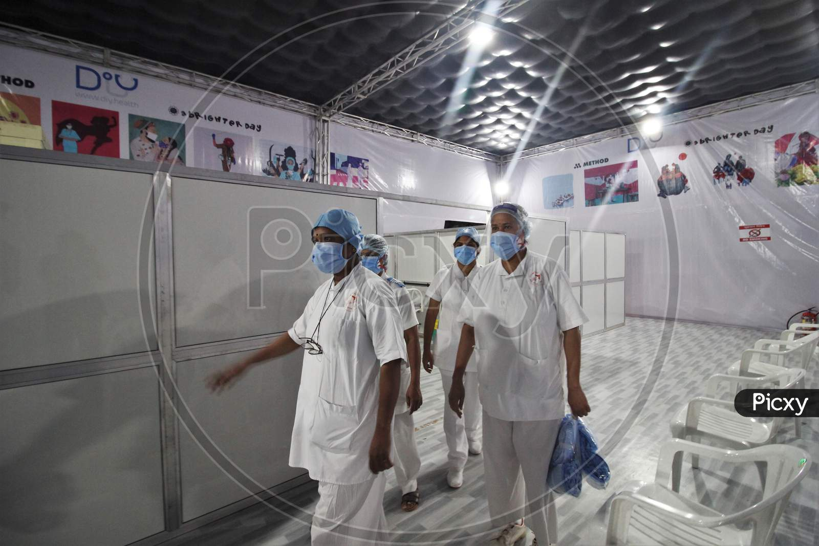 Nurses are seen showing around the newly inaugurated temporary facility created to screen cancer patients for covid-19, in Mumbai, India on July 30, 2020.