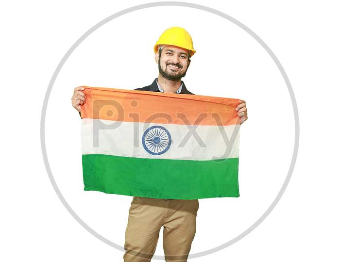 Happy Young Engineer Man Holding Indian National Tricolor Flag And Showing Patriotism, Republic Day Or Independence Day Concept Isolated On White Background