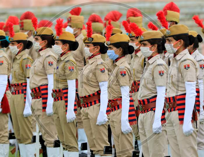 Indian police personnel wearing face masks take part in a final rehearsal for the upcoming ceremony to celebrate India's Independence Day In Ajmer, On August 13, 2020.