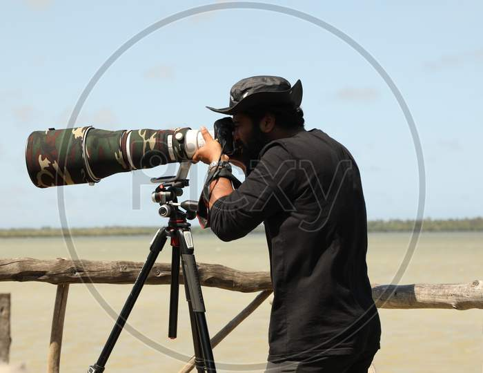 Travel Photographer in the work