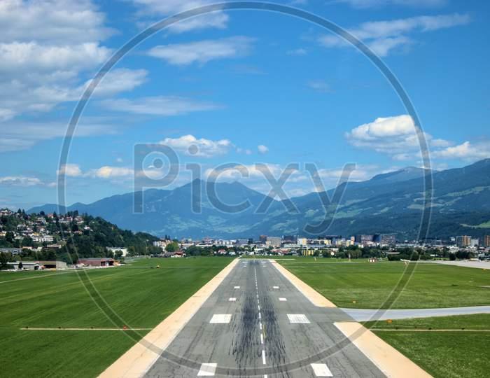 Runway strip of the Innsbruck international airport in Austria 5.7.2020