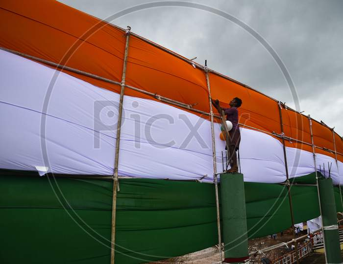 A worker make arrangements for the upcoming 74th Independence Day celebrations at Indira Gandhi Municipal Corporation Stadium, in Vijayawada, India, August 13, 2020.