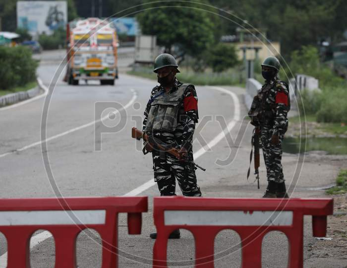 CRPF personnel stand guard along the Jammu-Srinagar highway near Jammu, ahead of the 74th Independence day celebrations  in Jammu on August 14, 2020.