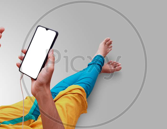 Girl Watching Mobile Phone With Hand Gestures And Wearing Earphone Mockup
