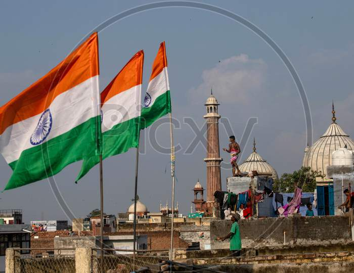 People fly kites from rooftops as they celebrate Independence Day in the old quarters of Delhi, India, August 15, 2020.