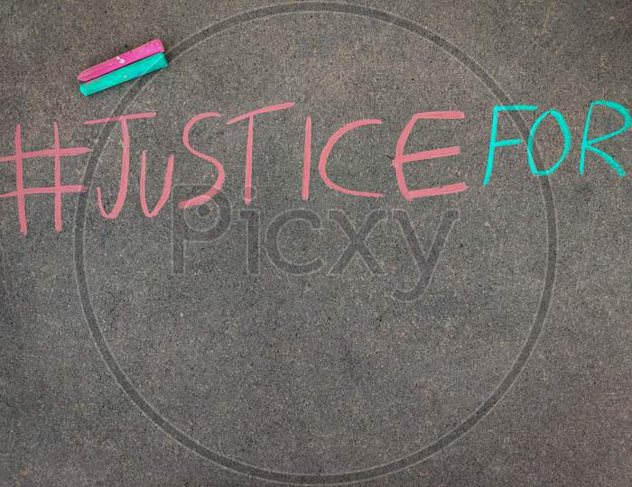 The Inscription Text On The Grey Board, #Justice For. Using Color Chalk Pieces. Copy Space