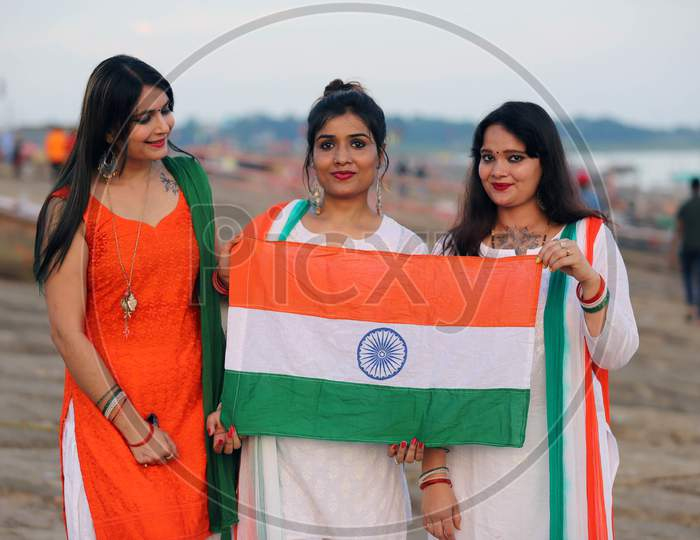 Women celebrate Independence day on the river bank of Sangam in Prayagraj, August 15, 2020.