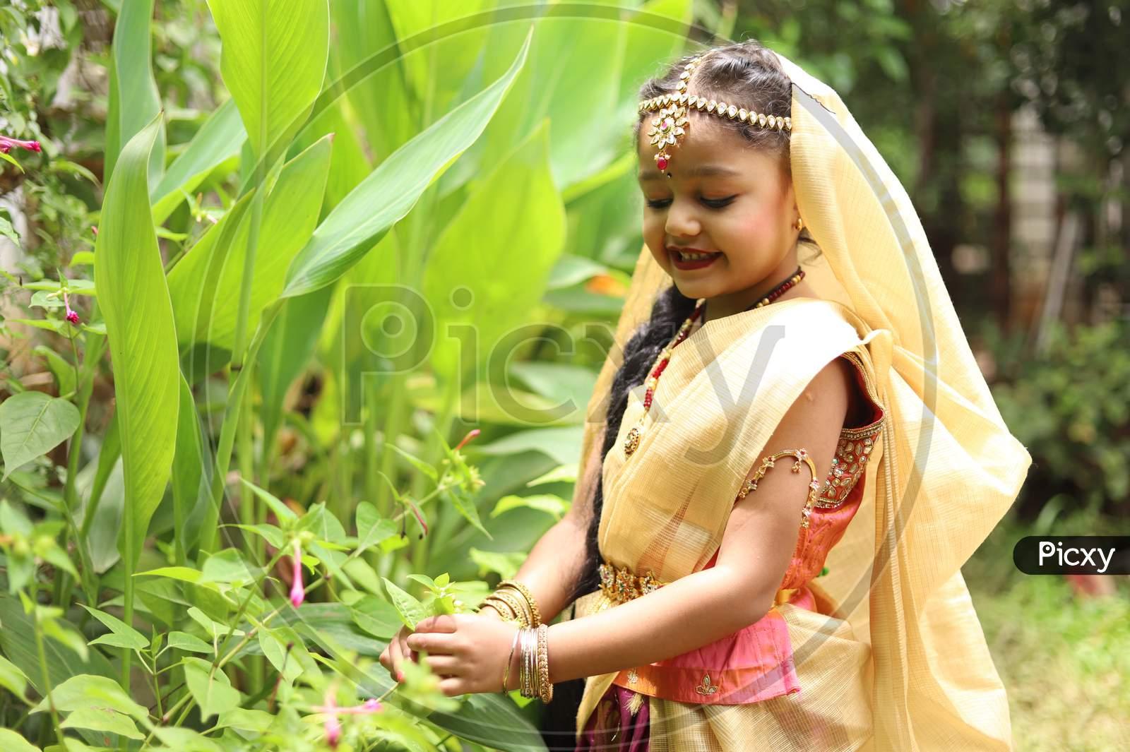 Cute littl girl dressed as Radha for celebrating janmasthmai