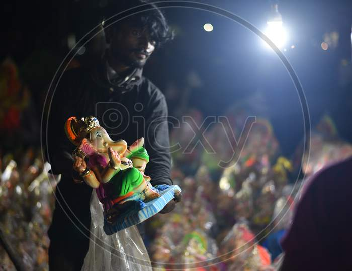 A vendor shows idols of hindu deity, Lord Ganesh ahead of Ganesh Chaturthi/ Vinayaka Chavithi festival in Hyderabad on August 21, 2020.