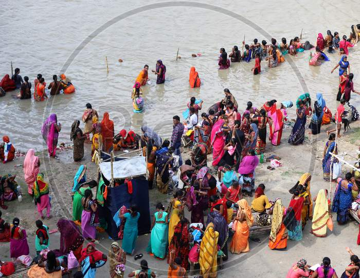Hindu women devotees take holy dip in the Ganga river on the occasion of Teej festival for the long life of their husband in Prayagraj, August 21, 2020.