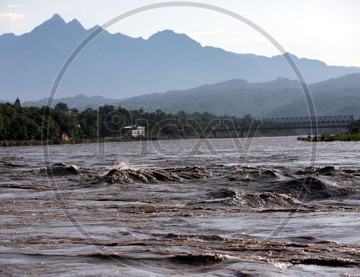 The river Chenab in full spate in Akhnoor area of Jammu on August 22, 2020 after authorities opened Salal Dam reservoir gates following heavy rains over the past two days in Jammu and Kashmir.