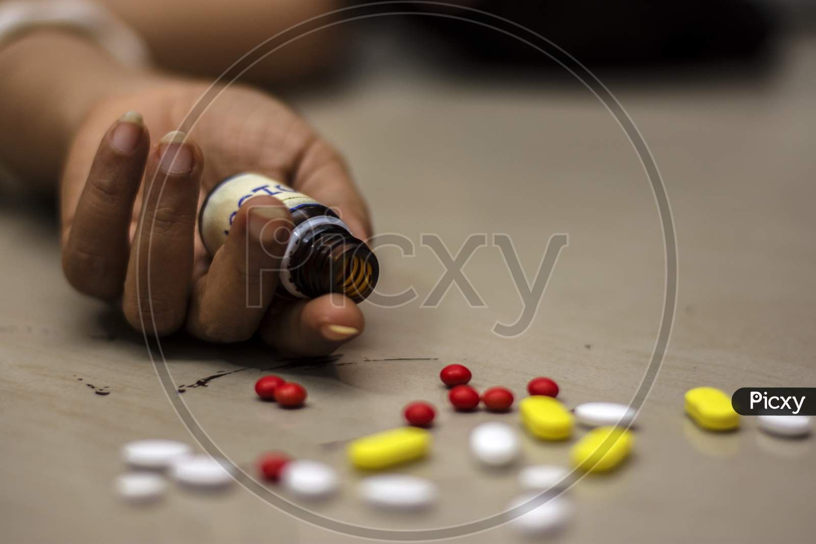 Bottle Of Poison Pills In A Female'S Hand Committing Suicide By Overdosing Of Medication.
