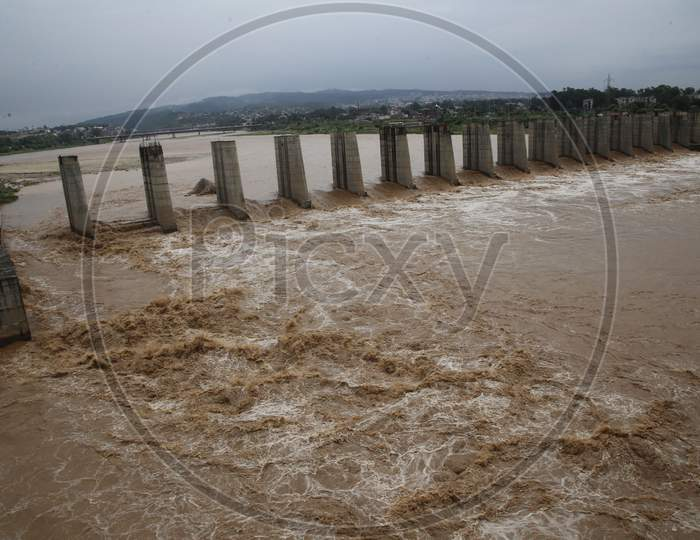 A view of flooded Tawi River after heavy rains, in Jammu  on August 25,2020.