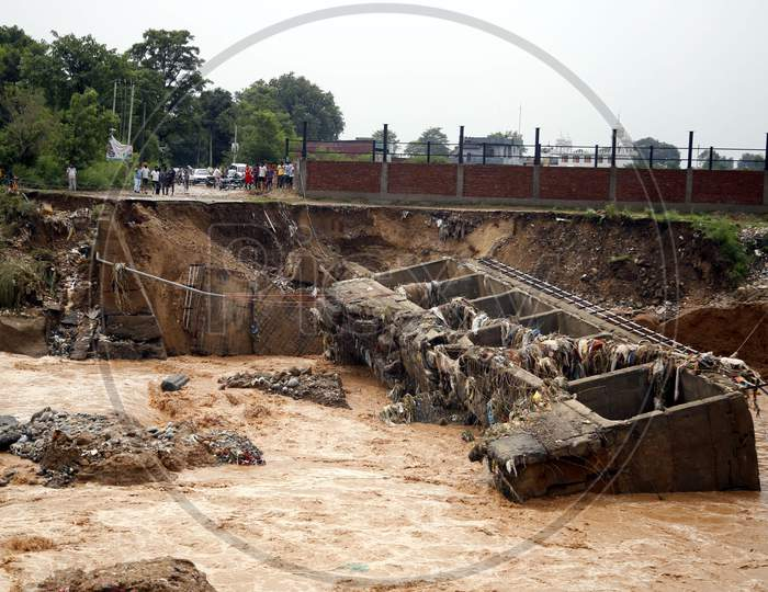 Destroyed a bridge over a stream after a heavy rain in the outskirts of Jammu,  26 August 2020.