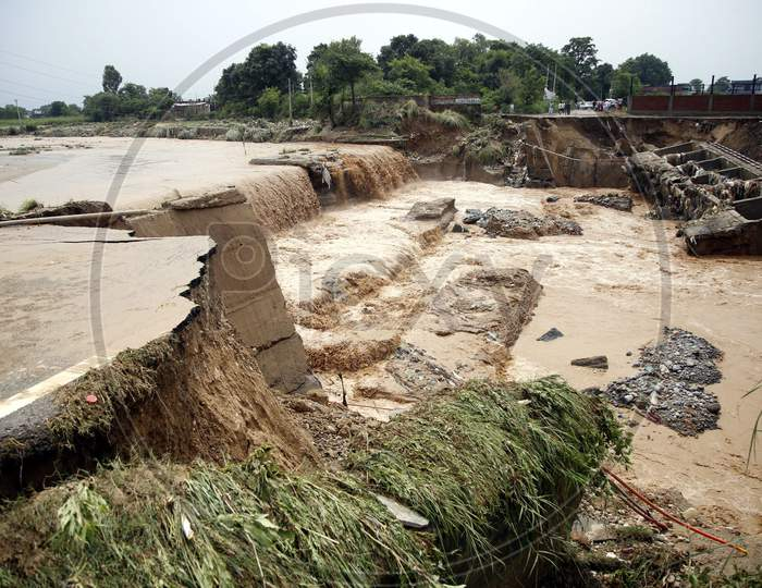 Destroyed bridge over a stream after a heavy rains in the outskirts of Jammu,  26 August 2020.
