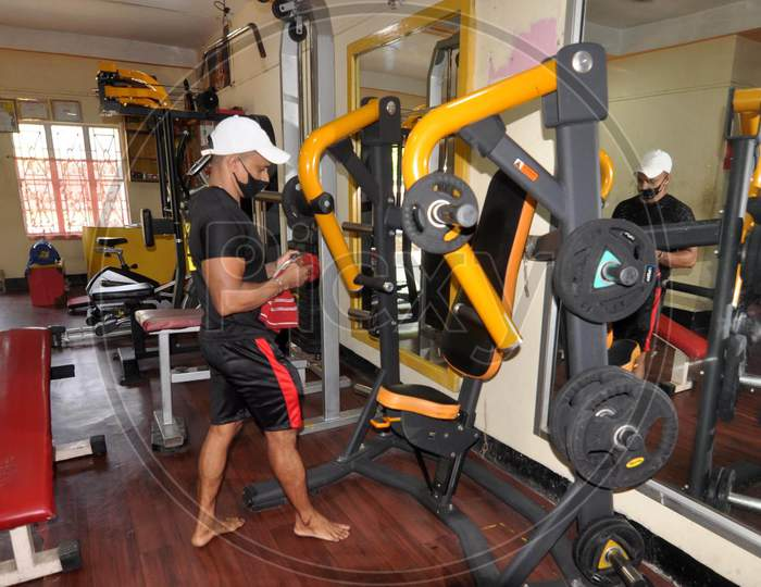 A Gym Instructor Sanitizes A Gym Before Its Reopening After Authorities Eased Lockdown Restrictions That Were Imposed To Slow The Spread Of The Coronavirus Disease (Covid-19), In Guwahati On August 3,2020