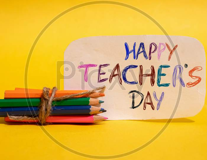 Happy Teacher's Day Written On Paper Note With Color Pencils, Perfect For Wallpaper
