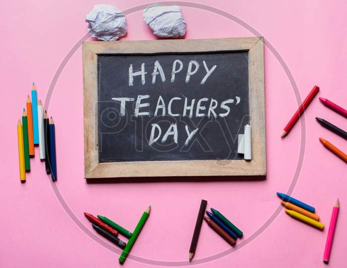Happy Teacher's Day Creative Photo With Chalkboard And Pencils Isolated On Pink Background, Perfect For Wallpaper