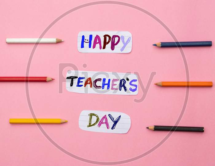 Happy Teacher's Day Conceptual Photo With Color Pencils Isolated On Pink Background, Perfect For Wallpaper