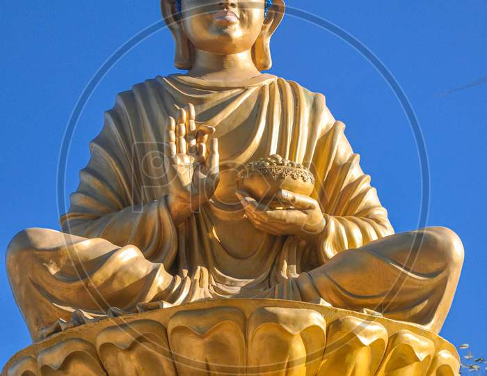 Goutam budha chanting under the open sky. Statue at darjeeling