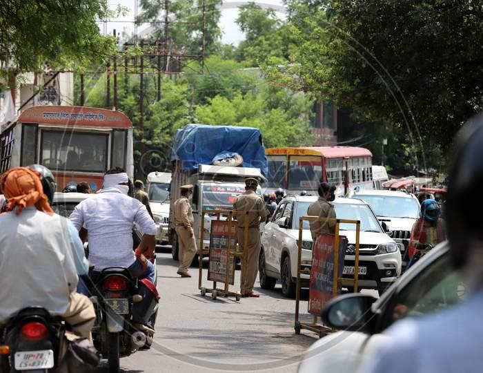 Police on high alert as they check vehicles ahead of Ayodhya's Ram Mandir ceremony, in Prayagraj, August4, 2020.