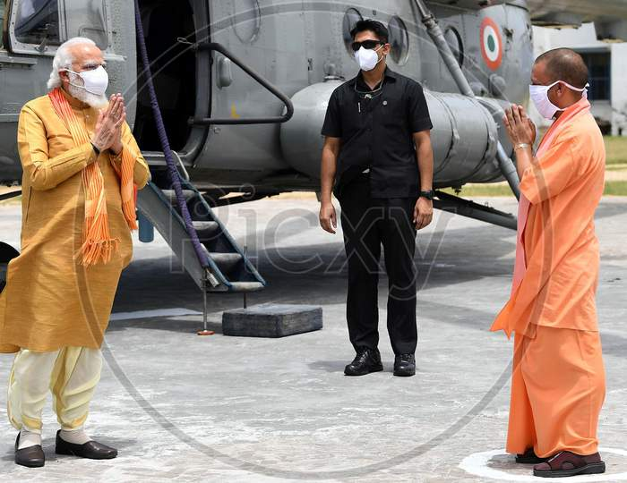 Uttar Pradesh Chief Minister Yogi Adityanath greets Prime Minister Narendra Modi as he arrives, ahead of the foundation laying ceremony for a Hindu Lord Ram's temple in Ayodhya, India, August 5, 2020.