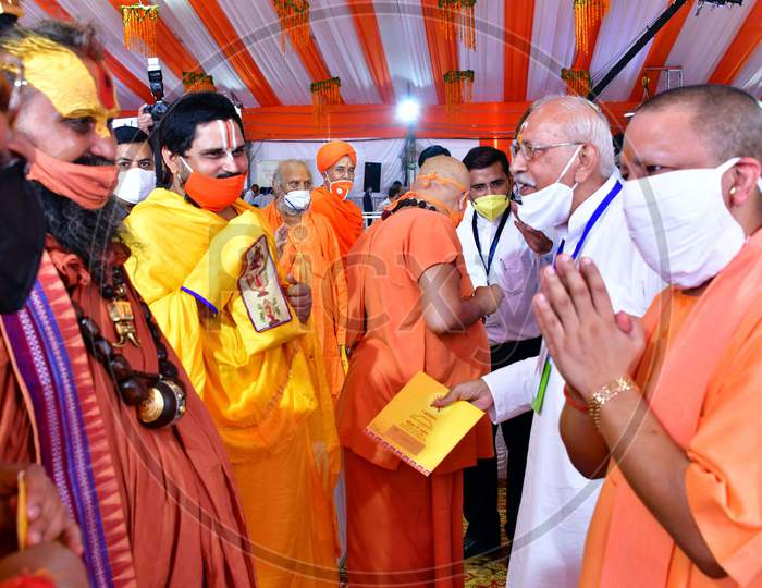 Uttar Pradesh Chief Minister Yogi Adityanath greets the local priests and Sadhus after the foundation laying ceremony for the Hindu Lord Ram's temple, in Ayodhya, India, August 5, 2020.