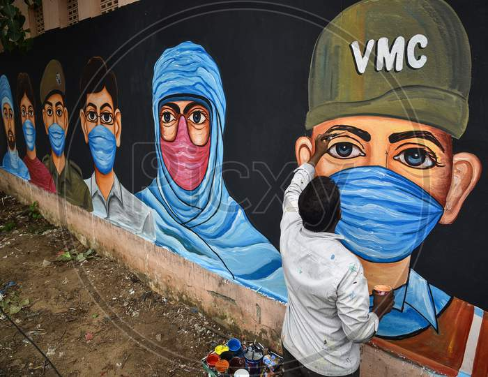 An Artist Paints A Mural On A Wall To Create Awareness On Wearing A Face Mask To Prevent The Spread Of Coronavirus, In Vijayawada, August 05, 2020.