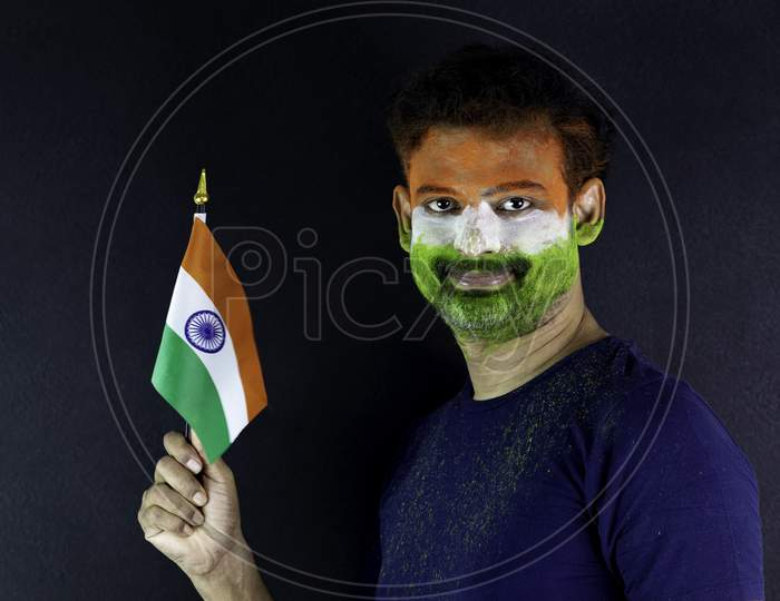 Young Man Holding Tricolour Indian Flag And Celebrating Independence