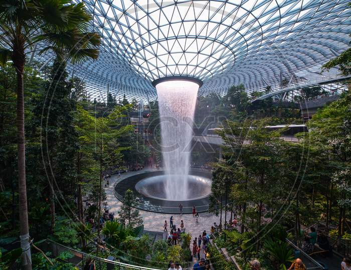 Jewel Changi Airport Rain Vortex. This is the largest indoor waterfall in the world and the centerpiece of Jewel Changi Airport. Singapore