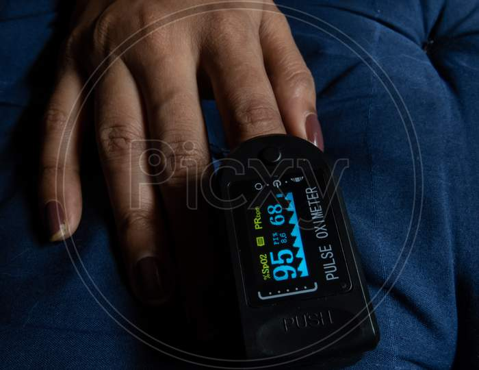 Measuring Of Pulse And Oxygen Level With Oximeter Machine.