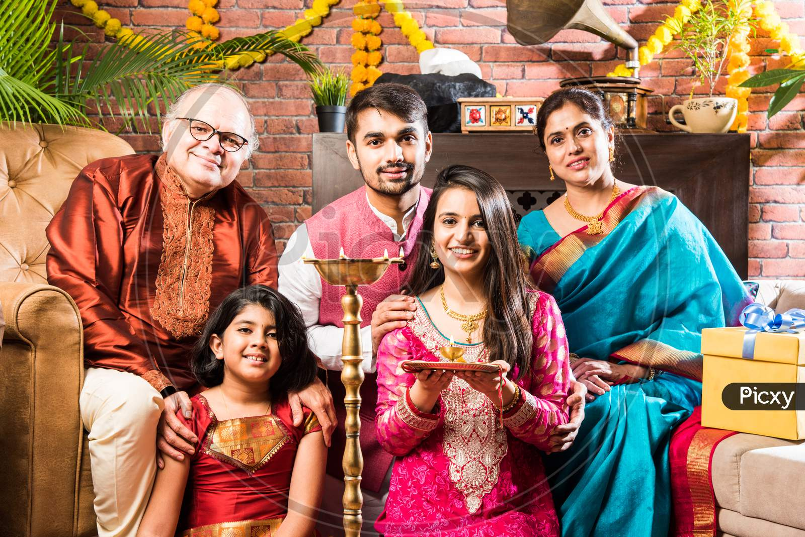 Happy Indian Family Performing Puja Or Pooja On Ganesh Chaturthi Festival