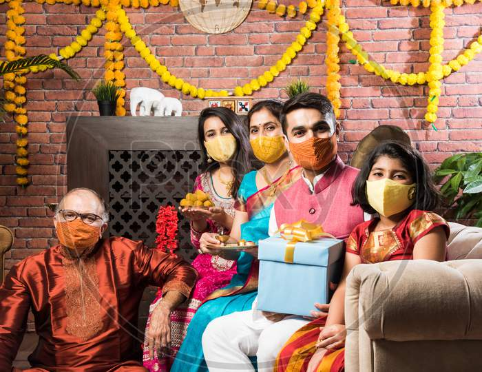 Indian Family In Group Wears Face Mask In Diwali Festival In Corona Pandemic