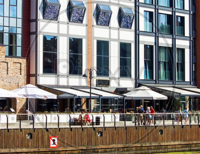 Gdansk, North Poland - August 14, 2020: Building Exterior And Restaurant Located In The Porch Over Motlawa River