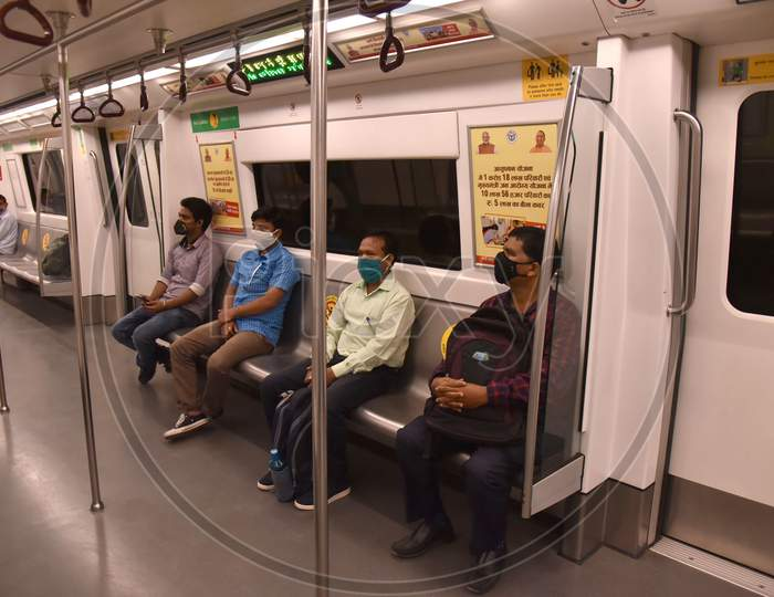 Passengers wearing face masks travel on a Delhi metro train, on the first day of the restart of their operations, amidst the spread of coronavirus disease (COVID-19), in New Delhi, India, September 7, 2020.