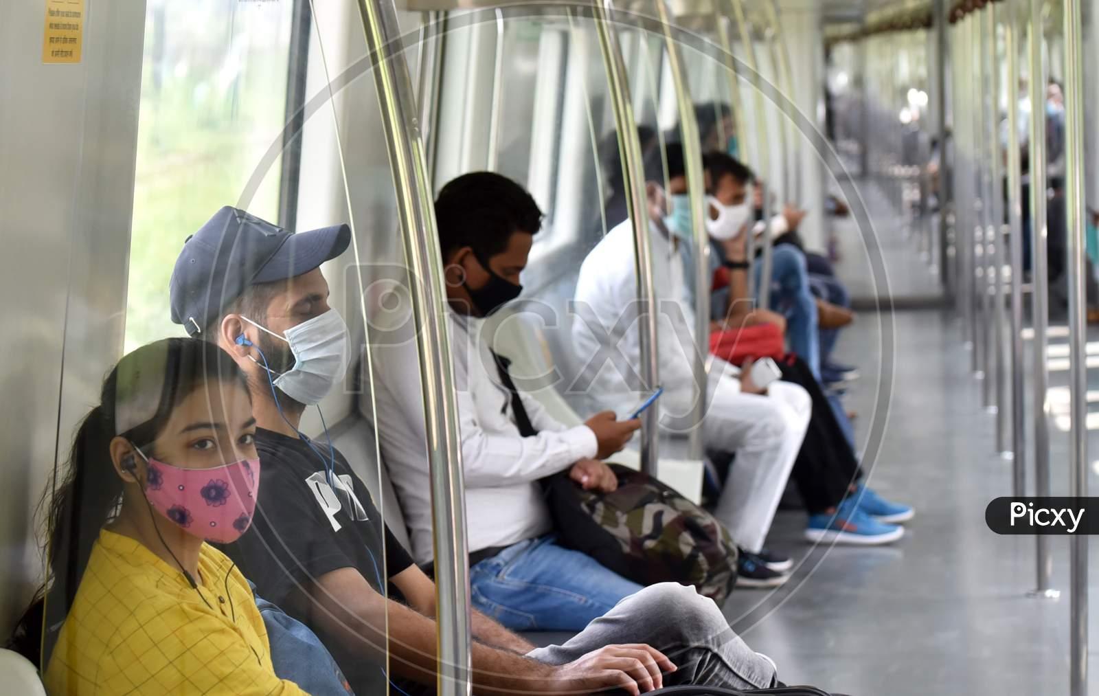 Passengers wearing face masks travel on a Delhi metro train, amidst the spread of coronavirus disease (COVID-19), in New Delhi, India, September 10, 2020.