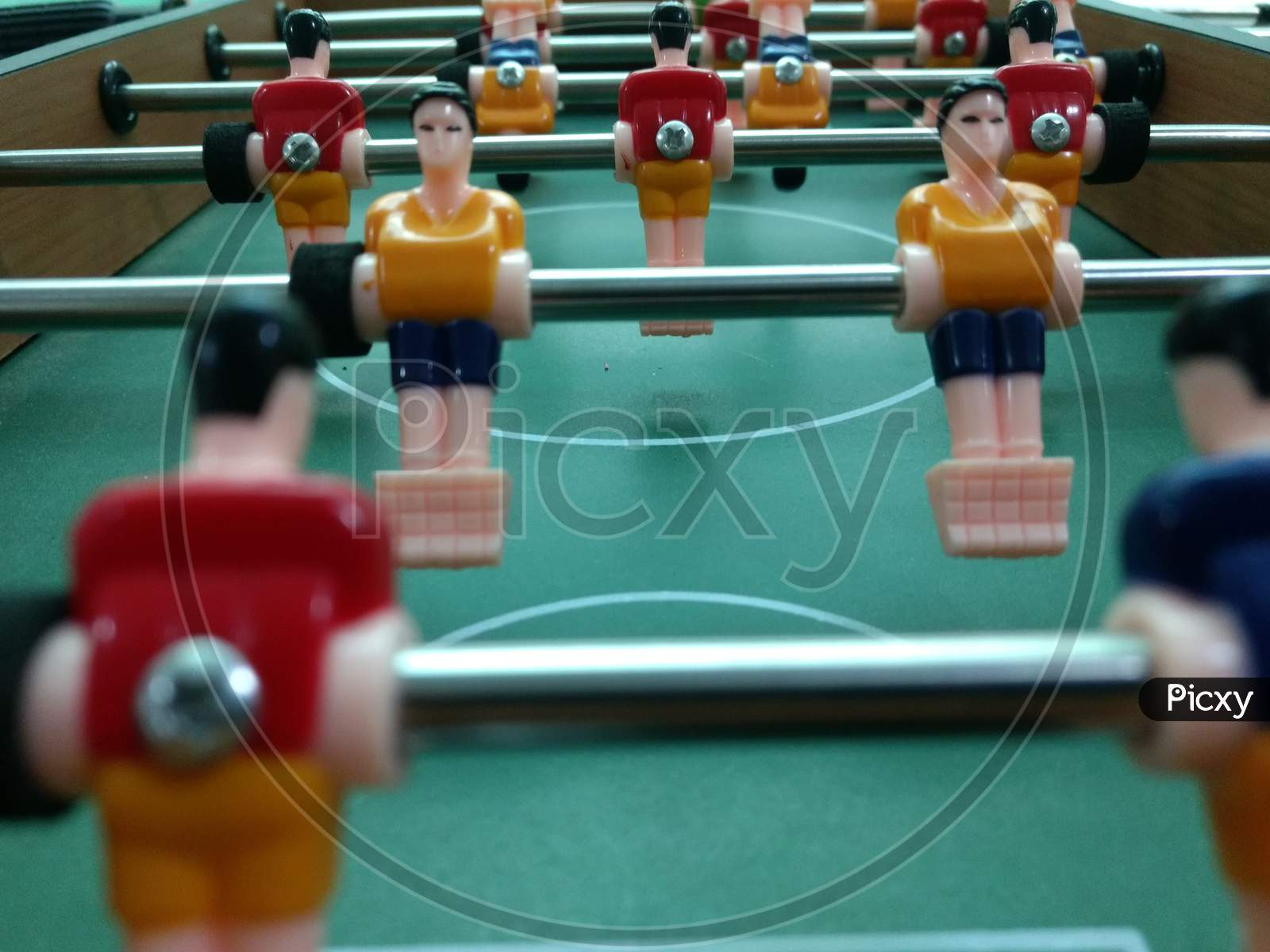 Foosball Table Football Game With Red And Yellow Players