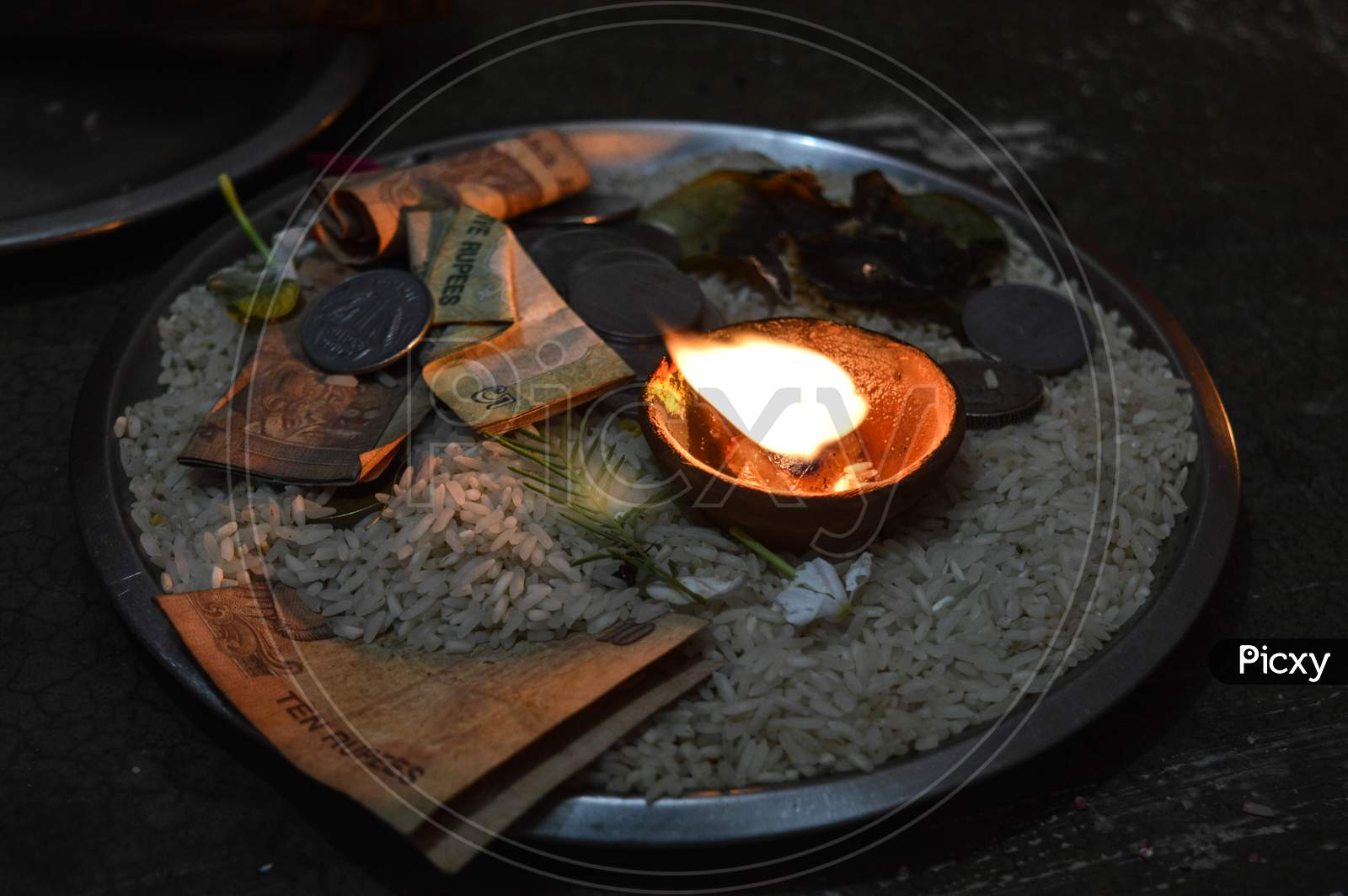 A Jar Is Which Is Loaded With Rose And Candle On Indian Festival Diwali Deepawali With Fire Isolated On Table