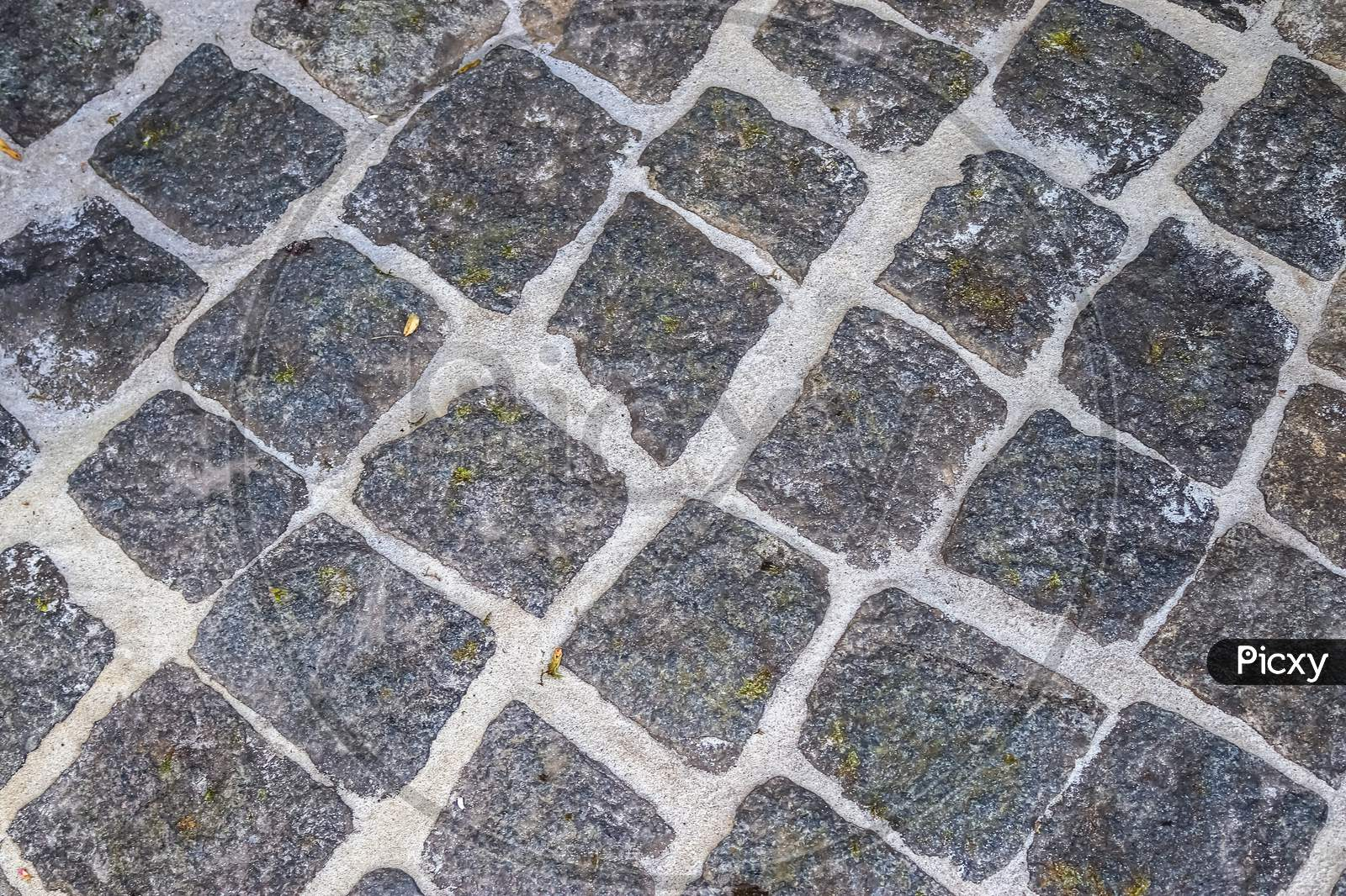 Detailed Close Up On Old Historical Cobblestone Roads And Walkways