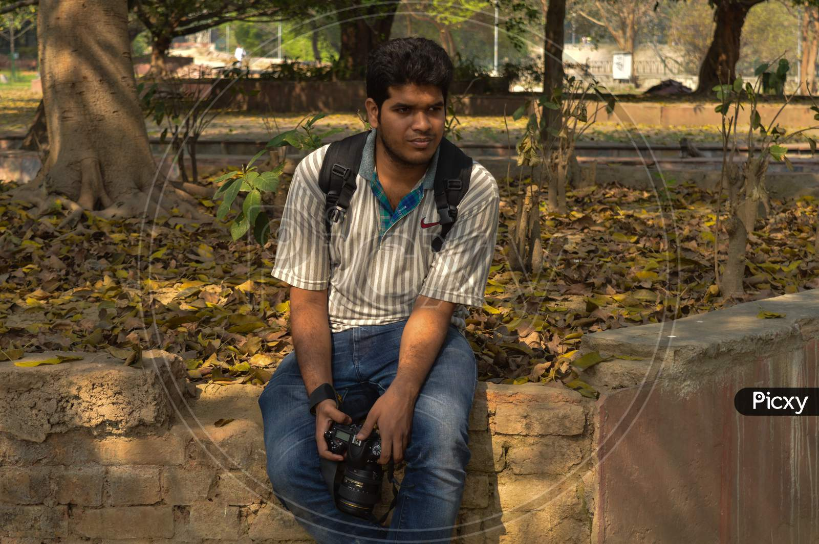 A Indian Guy,Boy With Nikon Camera D750 Doing Photo Shoot And Posing Inside Of Garden And Lake At Morning.