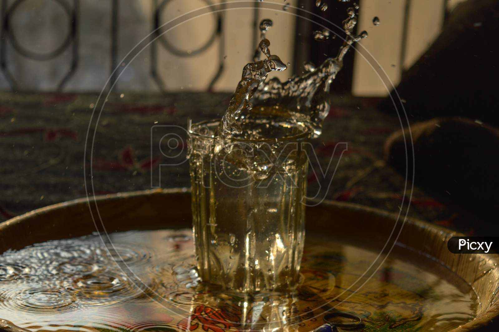 A Splash Photography Of Water Of Glass At Sunset Time.