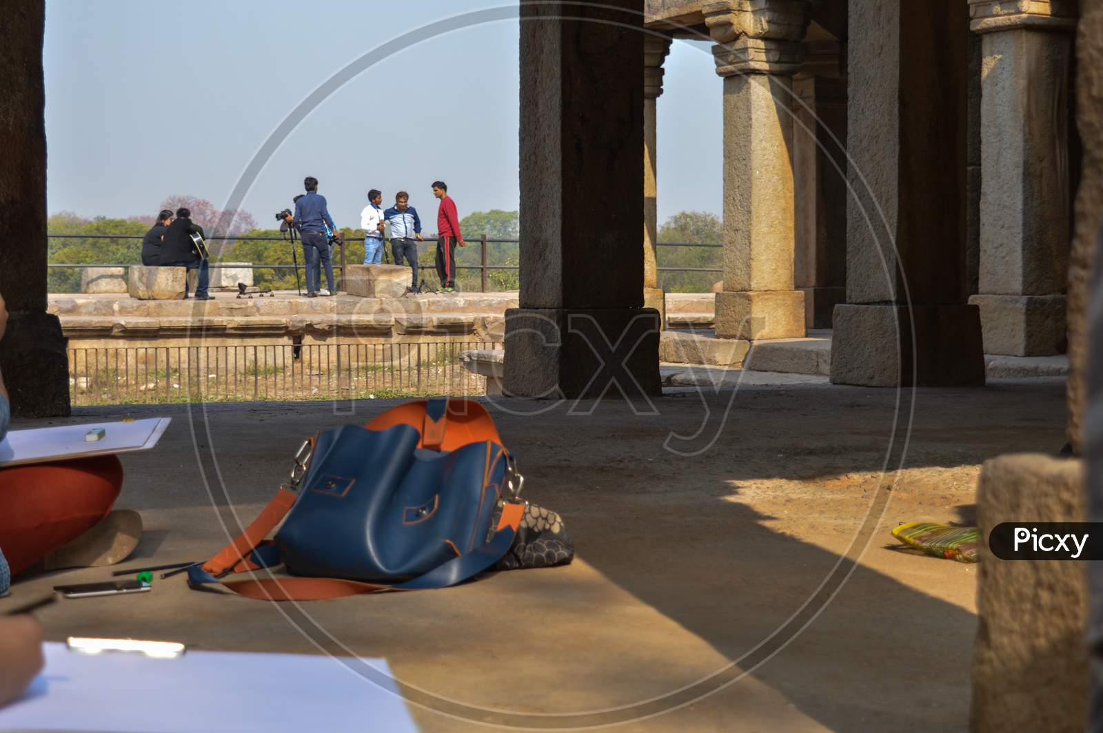 A Bunch Of Girls Is Drawing The Hauz Khas Monument And Garden From The Hauz Khas Fort At Hauz Khas Village At Winter Foggy Morning.